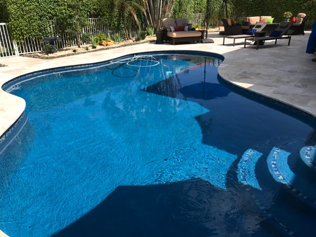 Choosing Between Travertine And Brick Pavers For Your Pool Deck All Seal Exteriors